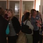 photo of event attendees talking
