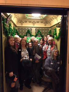 photo of a group of people in an elevator