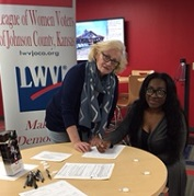 League member helping to register a voter